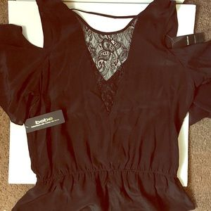 NWT Bebe silk and lace peplum top